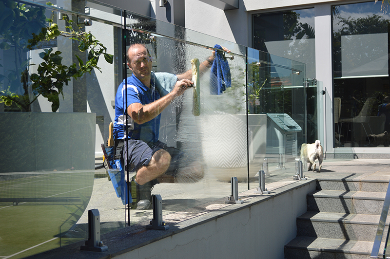 Cleaning poolside glass
